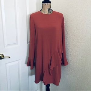 Blush colored ruffled dress with bell sleeves NWT